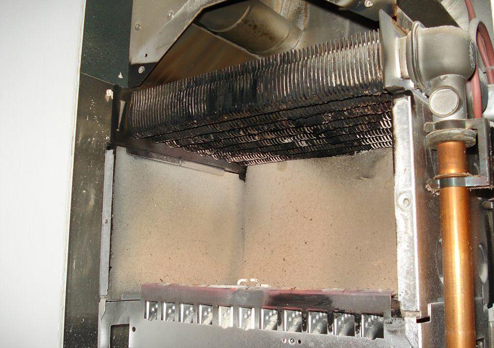 Засоренная камера сгорания газового котла