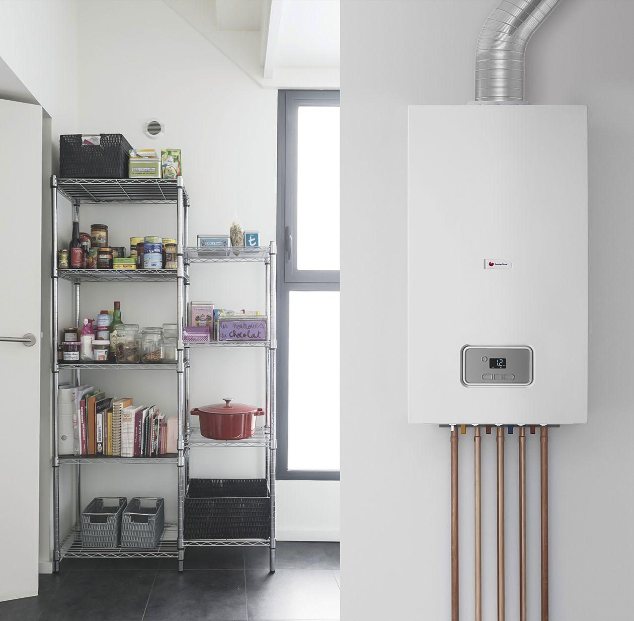 Навесной двухконтурный газовый котел в интерьере дома